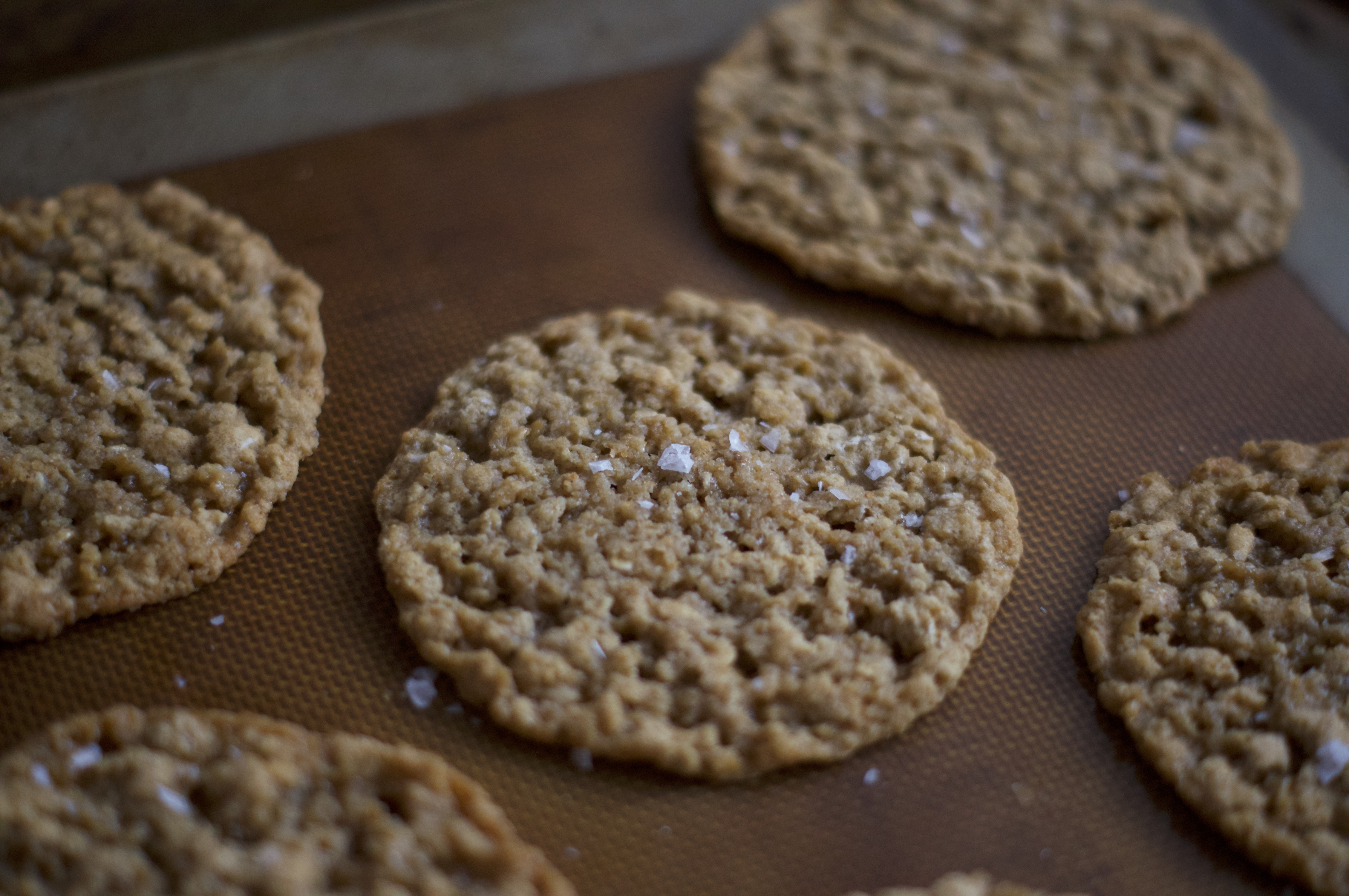 oatmeal lace cookies on a silicone baking mat
