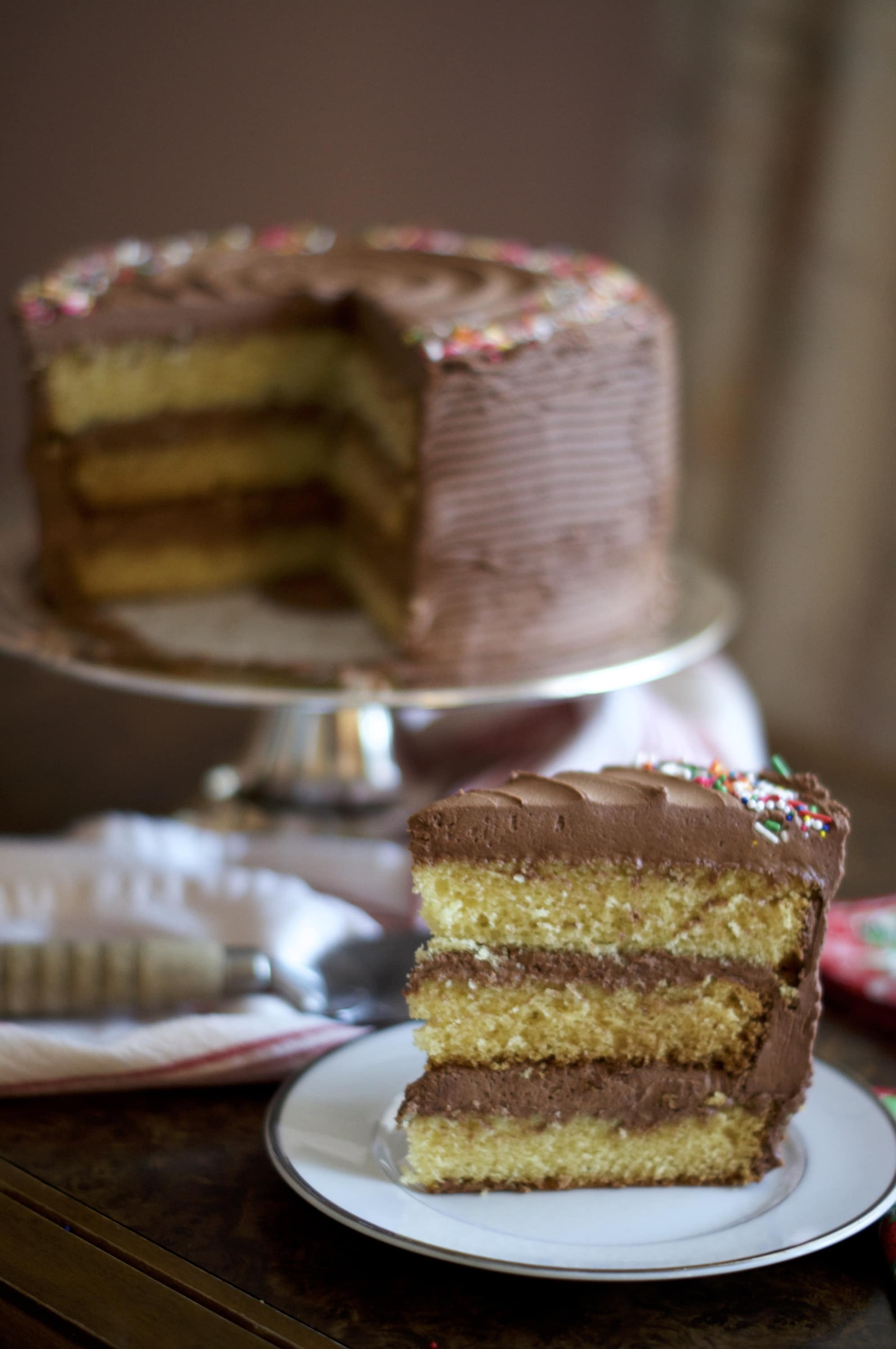 Yellow Cake with Chocolate Frosting   via Midwest Nice Blog