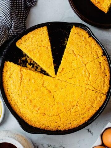Cast Iron Skillet full of freshly baked cornbread.