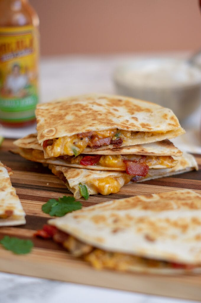 A front-on picture of a stack of simple breakfast quesadillas