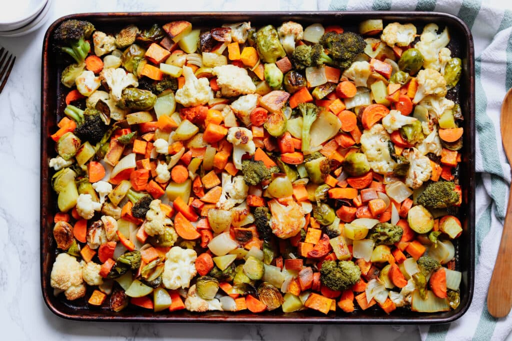 A sheet pan full of roasted mixed vegetables