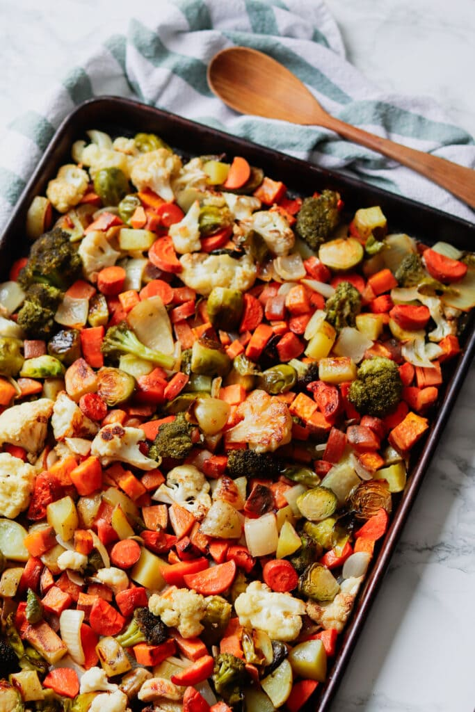 A sheet pan full of roasted mixed vegetables.