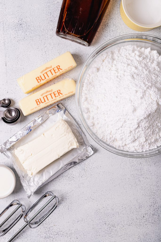 A flatlay of all the ingredients needed for the best cream cheese frosting recipe.