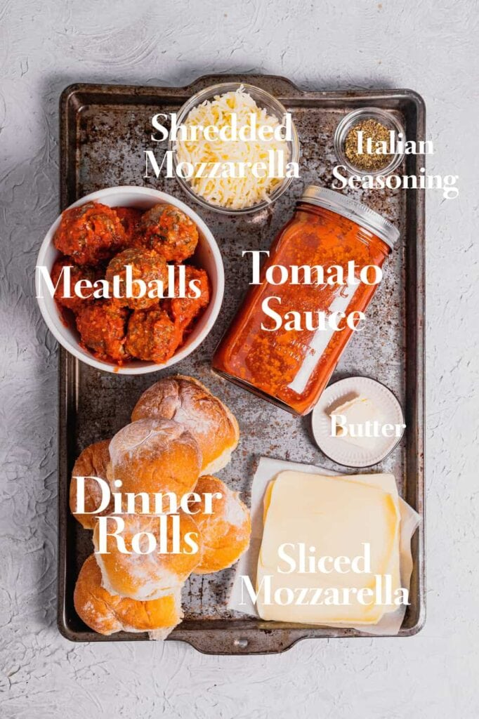A silver tray is filled with the ingredients to make this meatball sliders recipe.
