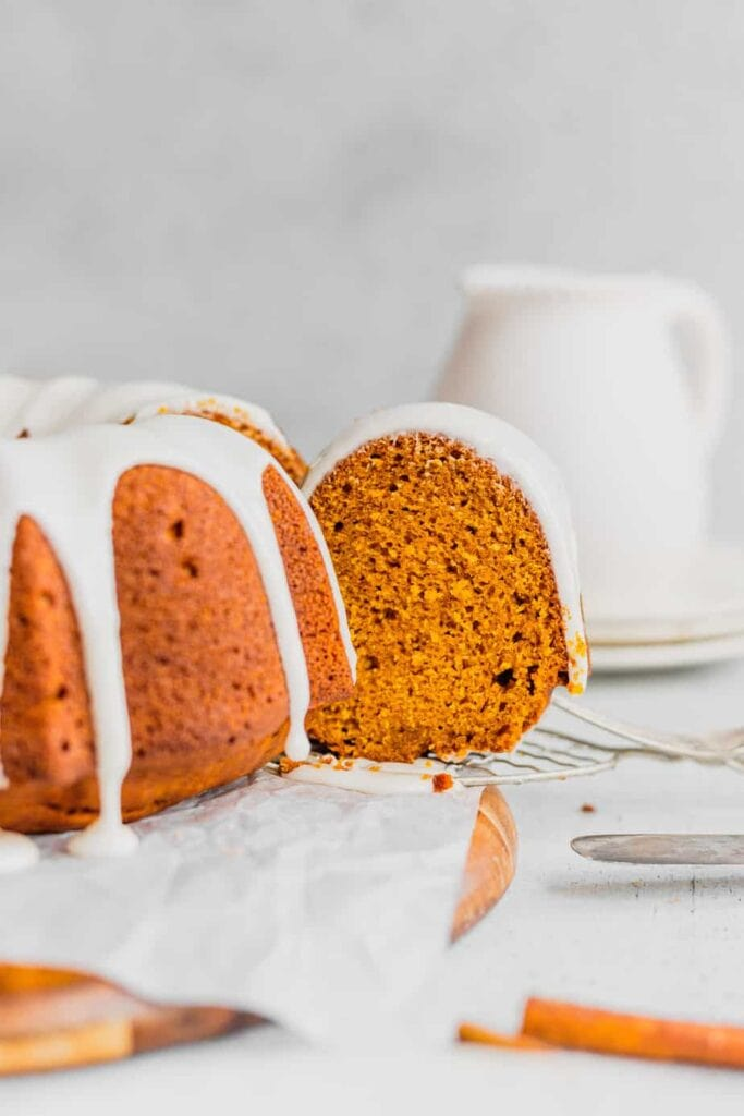 A straight on shot of a slice of pumpkin spice bundt cake.