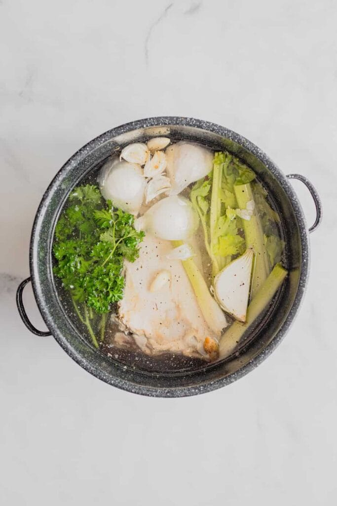 All the ingredients for homemade easy turkey stock are in a large stock pot.