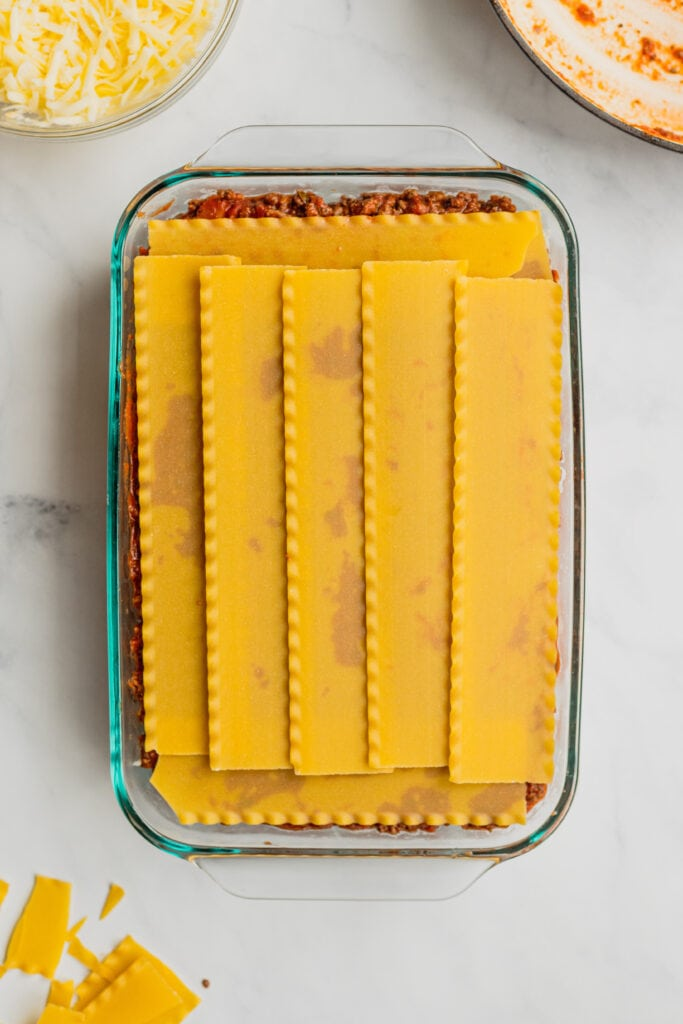 The third layer of noodles are added to a pan of my mom's best lasagna recipe.