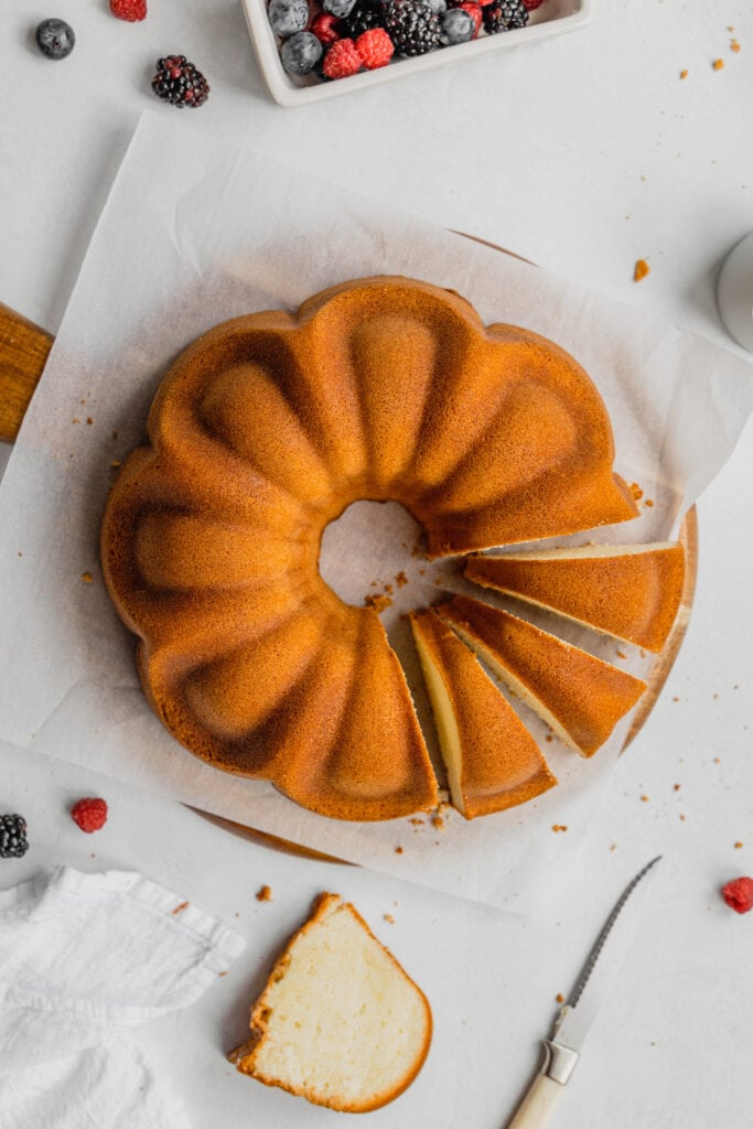 An overhead shot of an old-fashioned pound cake recipe with four slices cut out of it.