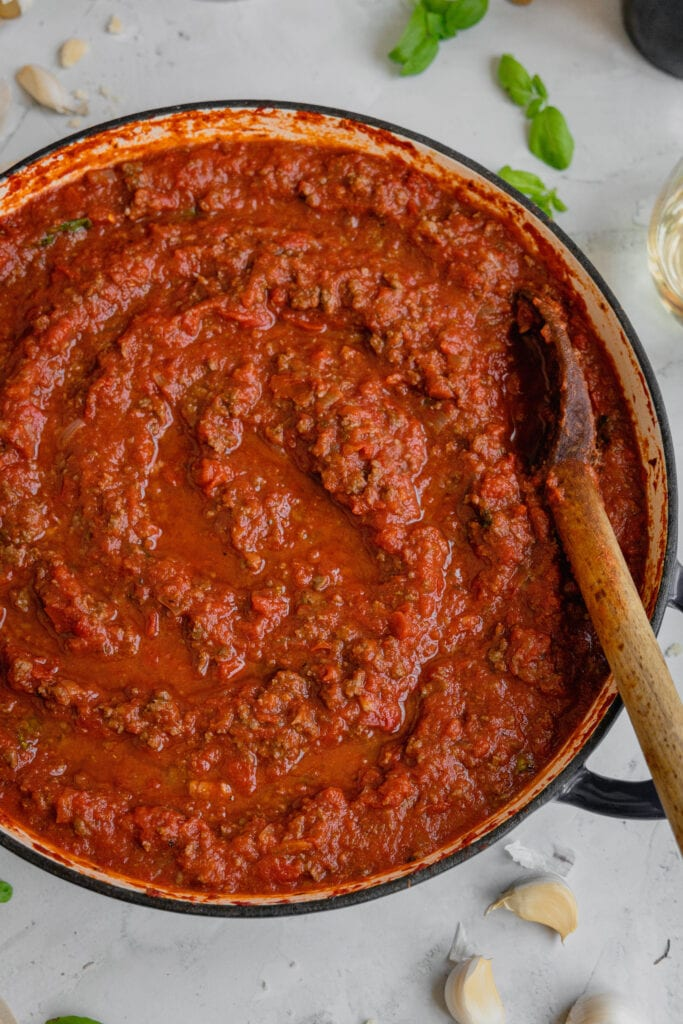 A large pot filled with venison meat sauce.