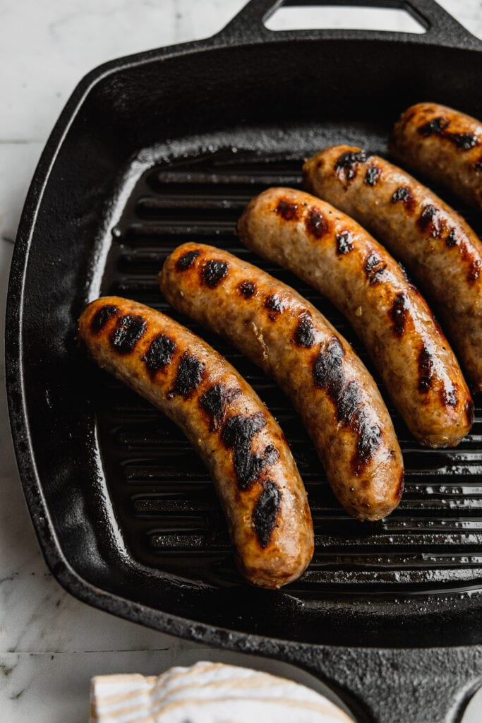 Beer brats in a grill pan.