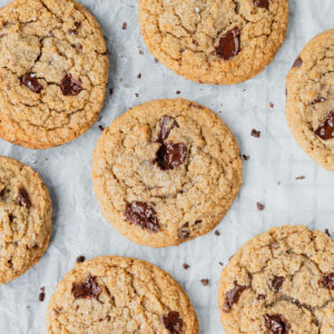 Browned butter chocolate chip cookies on a piece of parchment paper