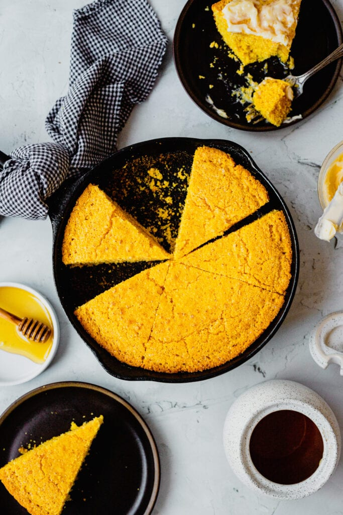 Freshly baked cornbread in a cast iron skillet.